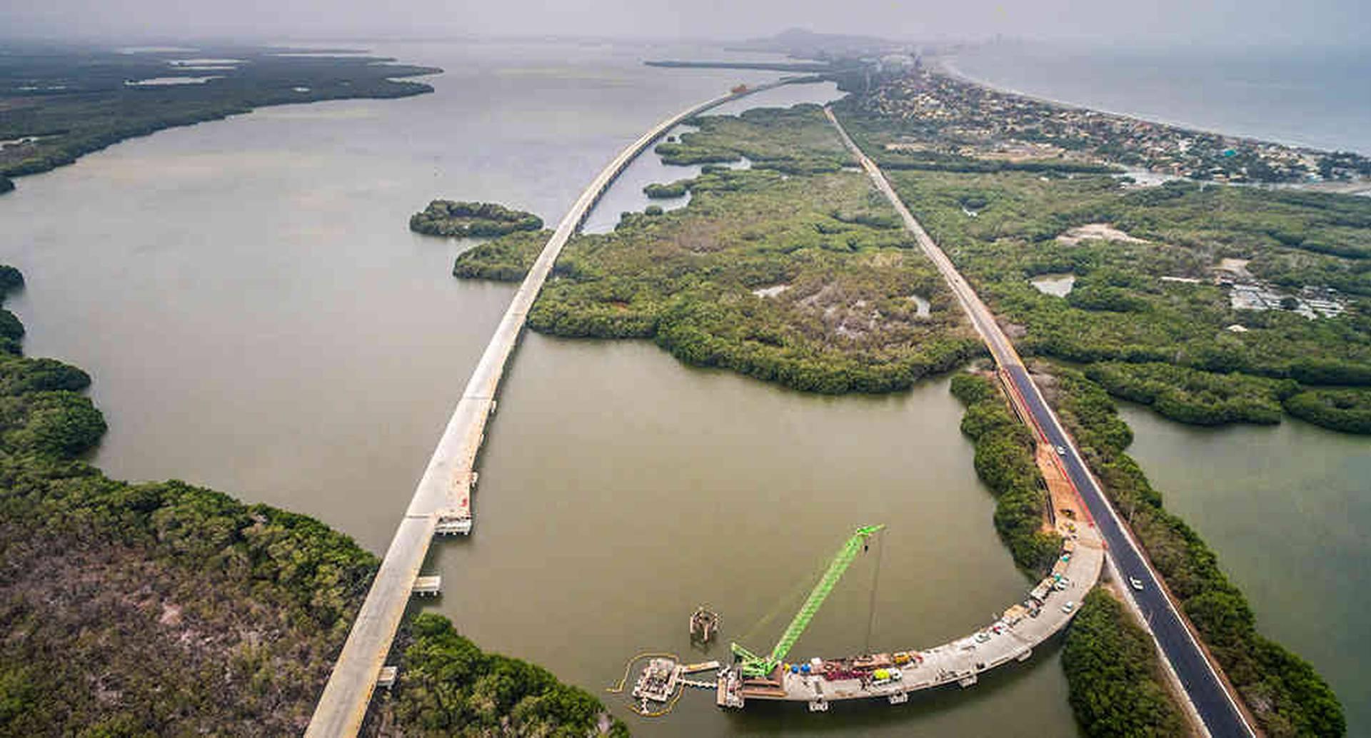 Ciénaga de la Virgen. En construcción: un viaducto de 4,73 kilómetros, del cual el 87 por ciento se ubica sobre la Ciénaga de Magdalena. Este se proyecta como el más grande de Colombia y el tercero de América Latina. Inversión: 687.290 millones de pesos. Beneficio: conecta al Caribe colombiano, específicamente a Cartagena y Barranquilla. Terminación de obra: junio de 2018.