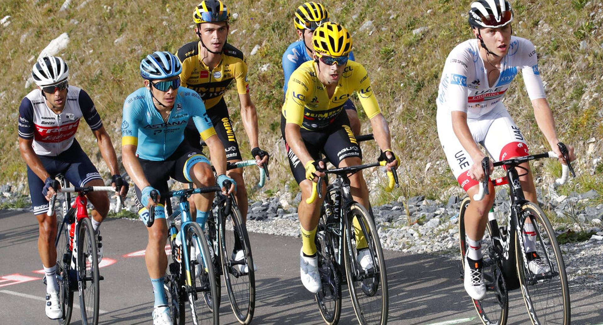 From left, Australia's Richie Porte, Colombia's Miguel Angel Lopez, Sepp Kuss of the US, Slovenia's Primoz Roglic wearing the overall leader's yellow jersey, and Slovenia's Tadej Pogacar, climb the Loze pass during the stage 17 of the Tour de France cycling race over 170 kilometers (105 miles), with start in Grenoble and finish in Meribel Col de la Loze, Wednesday, Sept. 16, 2020. (AP Photo/Christophe Ena)