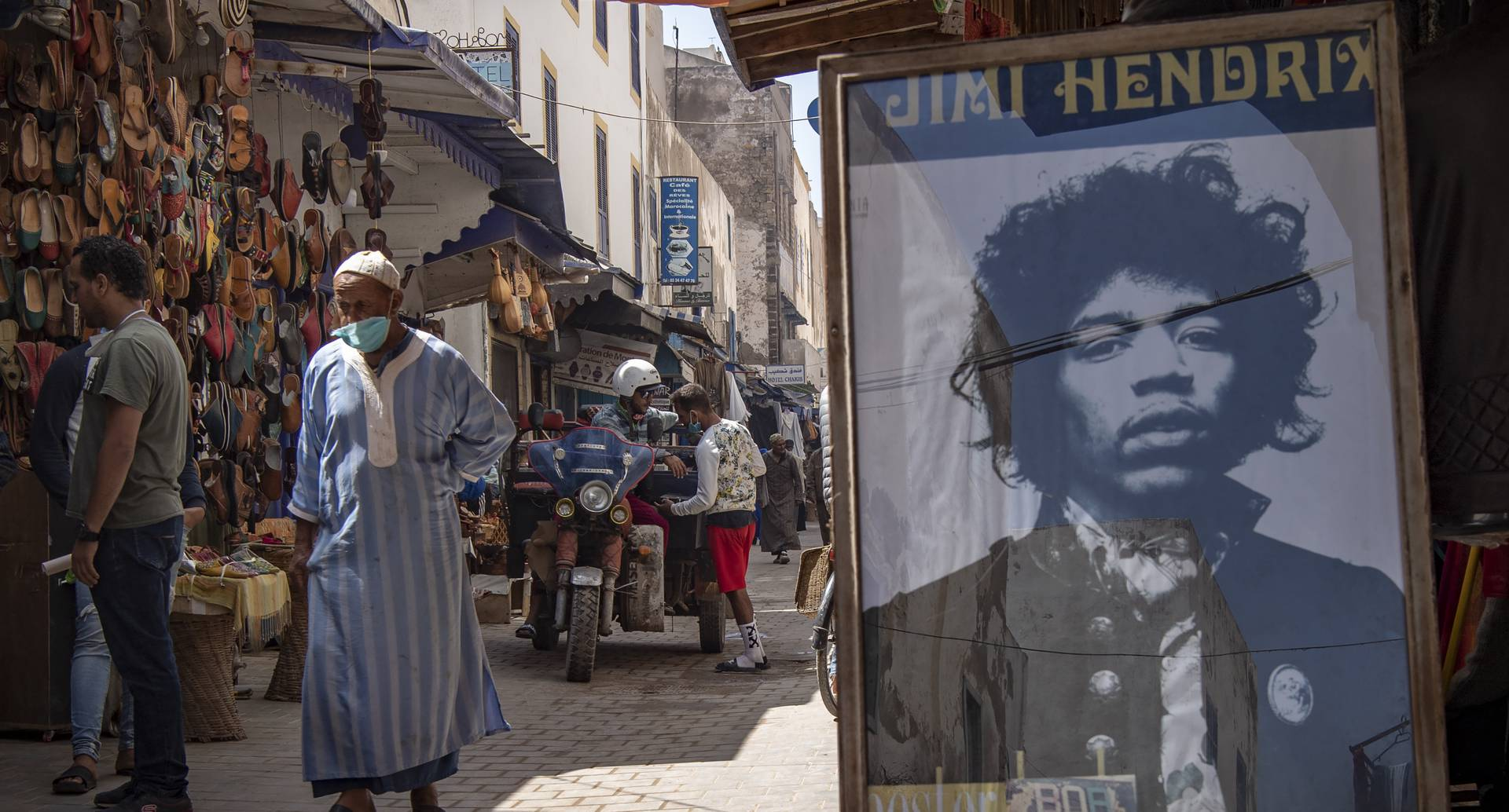 "A picture taken in the Moroccan coastal city of Essaouira shows portraits of late US guitarist Jimi Hendrix on September 10, 2020. - Some claim to have seen him, others to have spoken with him -- 50 years after guitar legend Jimi Hendrix's untimely death, a village on Morocco's Atlantic coast pulsates with his memory. In the Summer of 1969, Hendrix, the pioneering US guitar wizard whose whose hits included ""Purple Haze"" and ""Hey Joe"", made a brief stop in Essaouira, a former fort town and latter day tourist magnet located five kilometres (three miles) from his childhood village. (Photo by FADEL SENNA / AFP)"