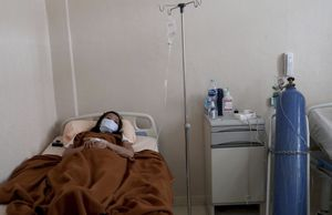 A COVID-19 patient lies in a hospital bed at Dr. Suyoto General Hospital in Jakarta, Indonesia, a country suffering from a devastating wave of coronavirus cases, fueled by the virulent delta variant first detected in India.  (AP Photo / Tatan Syuflana)
