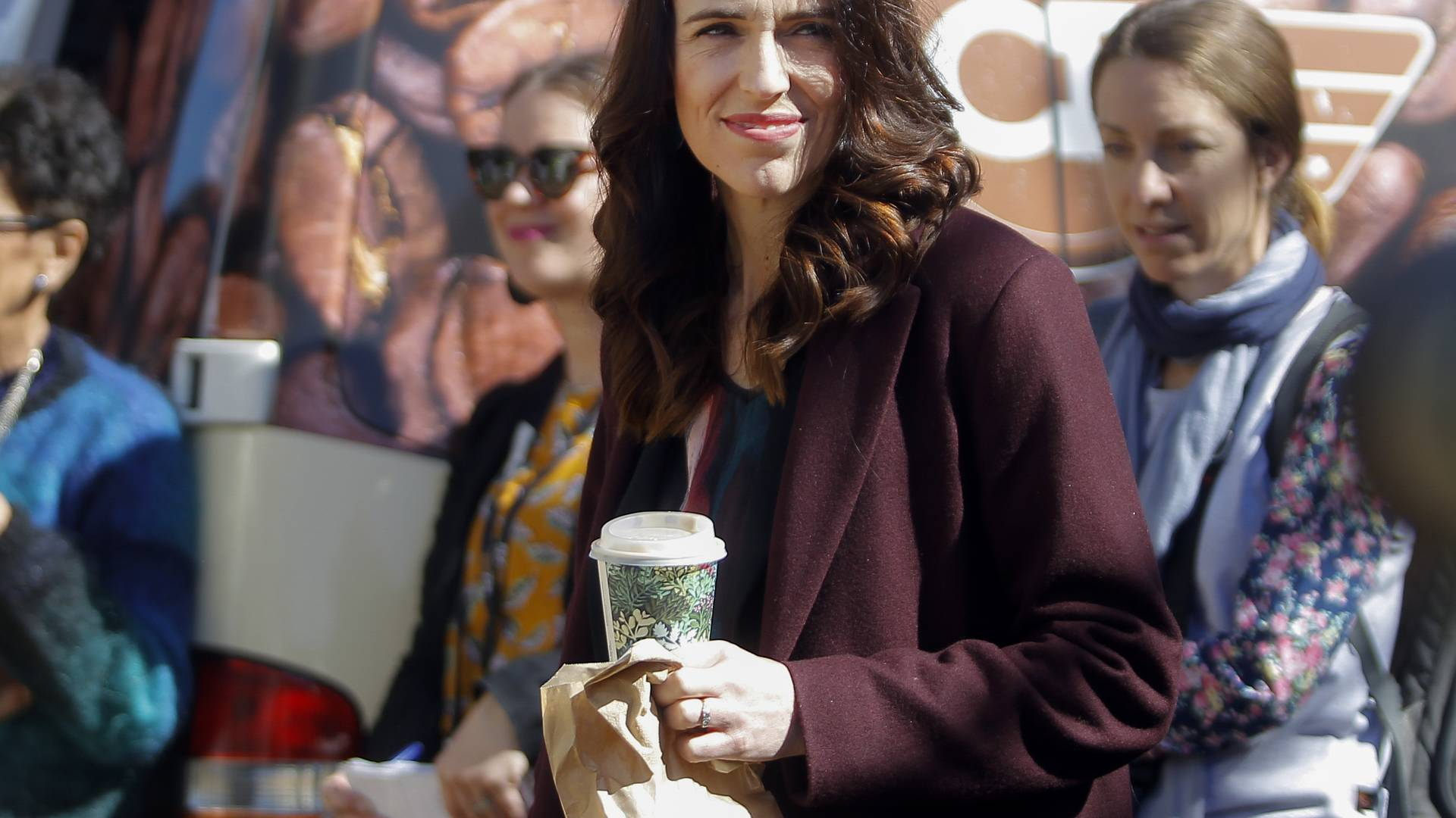 New Zealand's Prime Minister Jacinda Ardern carries her lunch during an event in Welcome Bay near Tauranga, New Zealand, Tuesday, Sept. 8, 2020. New Zealand will hold a general election on Oct 17. (George Novak/Bay of Plenty Time via AP)