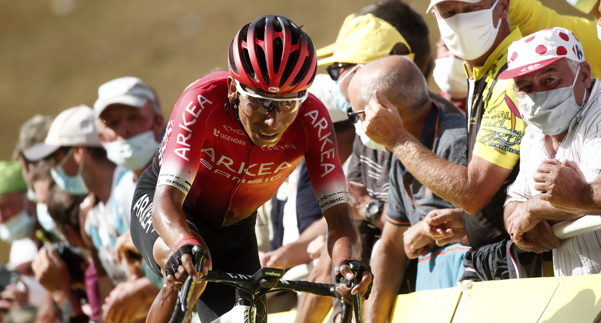 Colombia's Nairo Quintana crosses the finish line of the stage 13 of the Tour de France cycling race over 191 kilometers from Chatel-Guyon to Puy Mary, Friday, Sept. 11, 2020. (Benoit Tessier, Pool via AP)