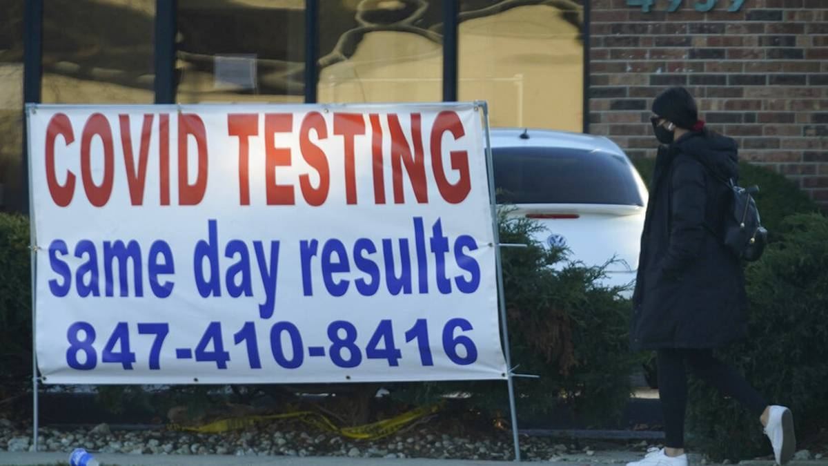 FILE - In this Nov. 28, 2020, file photo, a COVID-19 testing sign is displayed outside of the Elterman Center for Women's and Men's Health in Skokie, Ill. Deaths related to the coronavirus pandemic in Illinois have topped 200 for the first time. The record 238 fatalities reported Wednesday, Dec. 2, 2020, was nearly one-quarter higher than the previous high, set during the spring onslaught of the illness. (AP Photo/Nam Y. Huh File)